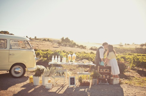 Bride and Groom with lemonade stand and combi van
