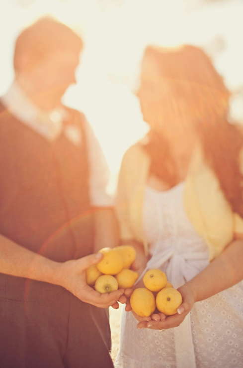 Bride and groom with lemons for engagement shoot
