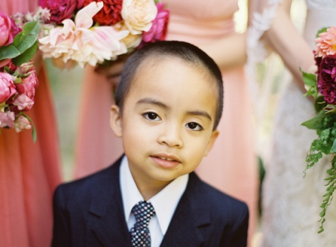 Pageboy at peach wedding