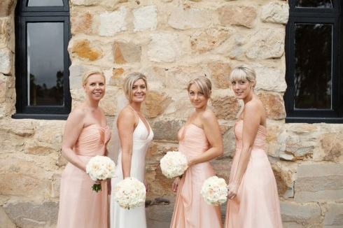 Peach bridesmaids at vineyard wedding