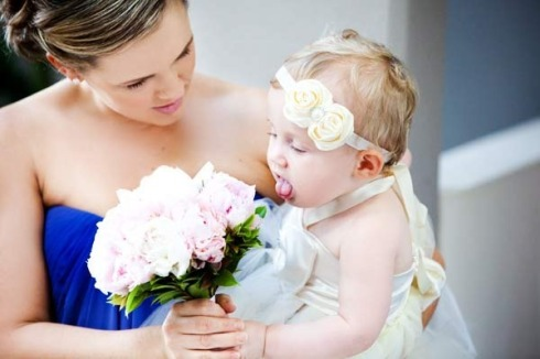 Bridesmaid with pink bouquet and blue dress