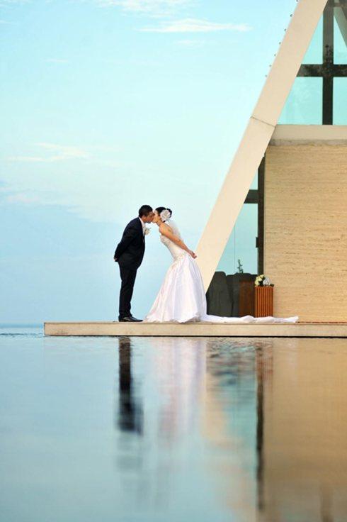 Danielle and Allan kissing outside the Infinity Chapel - Bali wedding