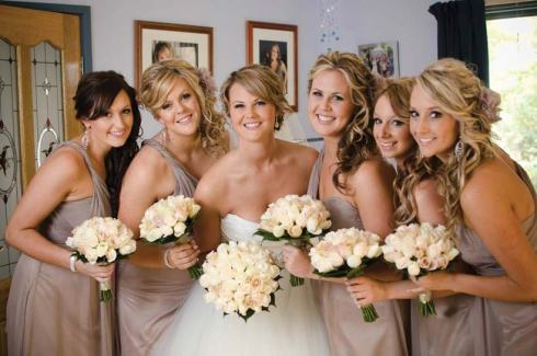 The bride and bridesmaids for a winery wedding